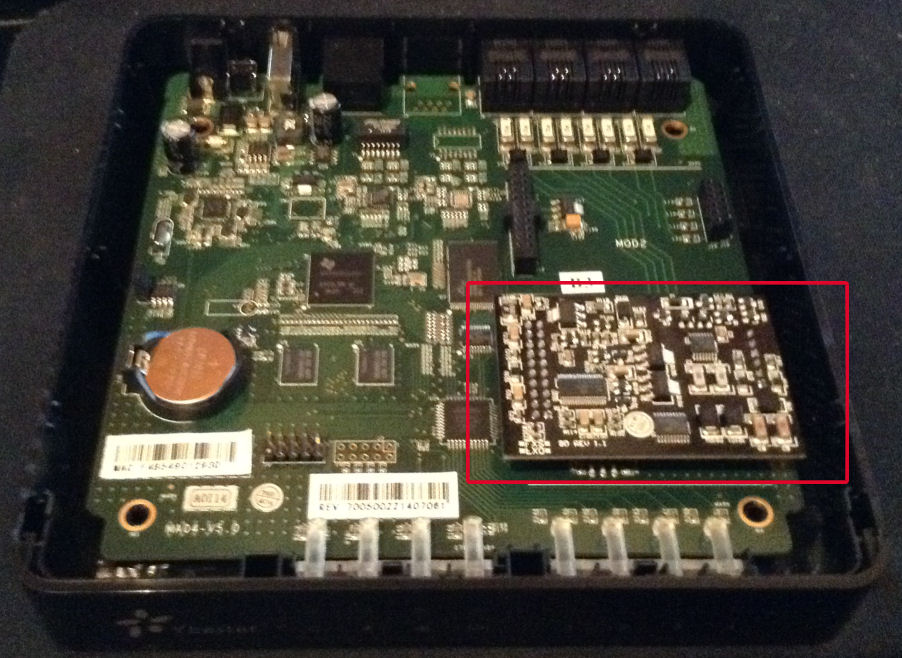 MyPBX Soho with top cover removed; slot 1 containing FXS/FXO module highlighted in red.